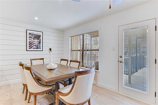 Photo #11 Dining Area flanked by a shiplap wall