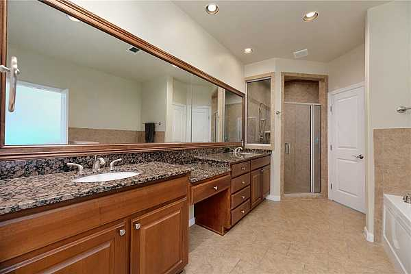 Photo #12 The en-suite is very spacious and has a large double vanity with ample storage space and a make-up area.