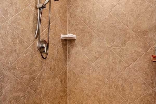 Photo #14 The en-suite also has a large walk-in shower with tile surround and an upgraded shower head.