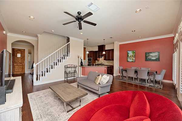 Photo #4 Stunning hardwood flooring and tall ceilings accentuated with elegant crown molding greet you as you enter the home.