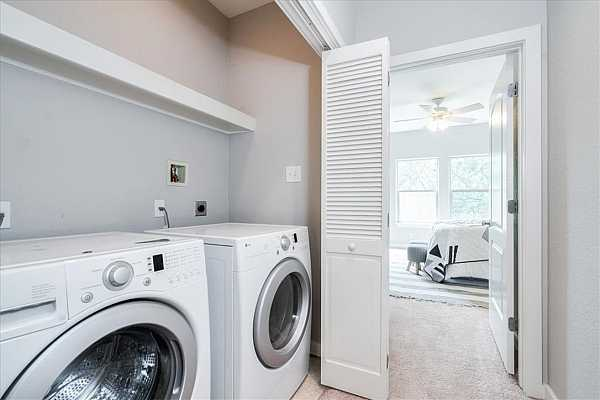 Photo #19 Full sized washer and dryers will fit in the closet, allowing you to easily accomplish all of your laundry