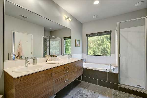 Photo #15 En Suite bath with double vanity sink and a large soaking tub to soak any cares away