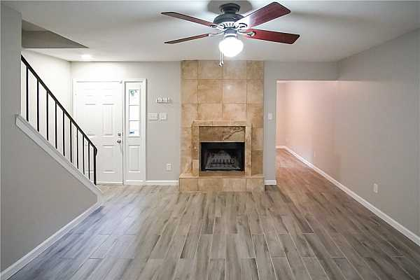 Photo #1 Front entry opens up to spacious living area complete with a fireplace, you