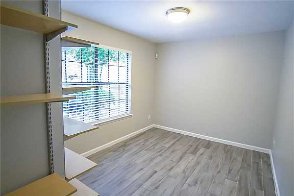 Photo #4 This rare end unit offers a dedicated office space downstairs, perfect for work from home!
