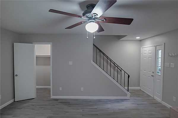 Photo #6 Closet under the stairs offers ample storage in addition to the outdoor storage closet