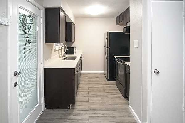 Photo #7 Fully remodeled kitchen with newer appliances
