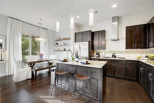 Photo #11 have a quick breakfast at the bar or a delicious meal cooked in your fabulous gourmet kitchen.  Granite counters, nickel hardware, pantry, and plenty of storage