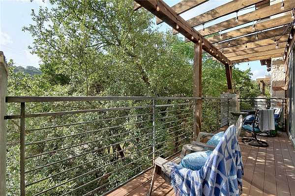 Photo #27 After a long day, the balcony calls you with the views of Austin hills, privacy with a few treetops, a  place to unwind and take a few moments to yourself.  Namaste...