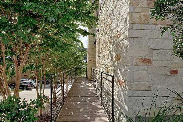 Photo #4 Accessible front entry to the front door.  Maximum curb appeal with stone fascia and iron banisters, beautiful landscaping.