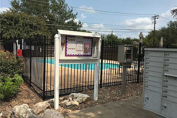 Photo #26 Master bedroom walk in close has a California Closet design to fully utilized storage space.  Pictured are 46 shoe sized spaces.
