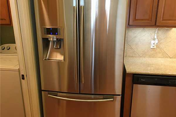 Photo #4 Upgraded, locking front glass door with operable lower pain and screen.  Provides for more natural light and fresh air.