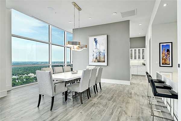 Photo #1 Open floor plan, soaring ceilings and windows for the best views of Austin