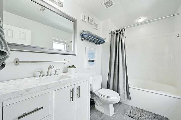Photo #20 Primary bath with updated vanity and floor tile.