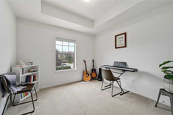 Photo #21 Secondary bedroom used as a music room but easily fits a queen sized bed.