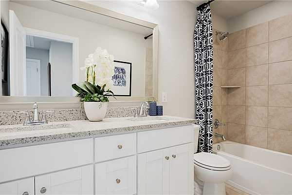Photo #10 * REPRESENTATIVE PHOTO. The secondary bathroom with shower, great storage vanity space and beautiful wall size mirror makes getting ready with ease in the morning.