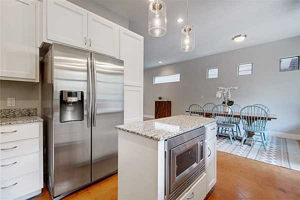 Photo #17 Easily serve meals with the kitchen just a few steps from the dining area