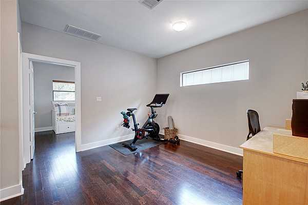 Photo #18 You will love this great flex space on the 2nd floor that can be used as an office, work out area or studio