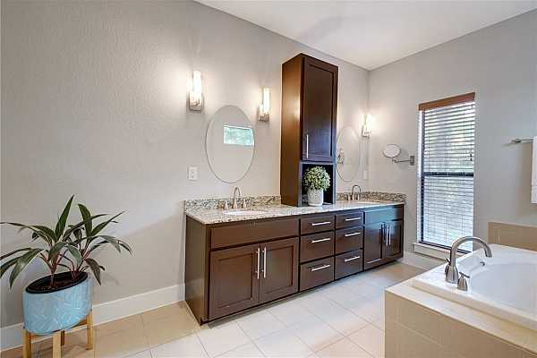 Photo #22 The spa-like ensuite bath is an absolute dream to get ready in