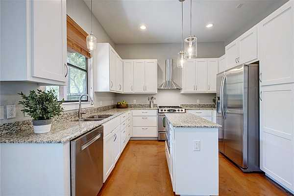 Photo #3 The kitchen not only features impeccable style, it