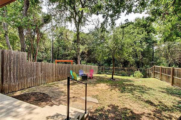 Photo #31 Garden, play, relax; there is space for it all in this private backyard
