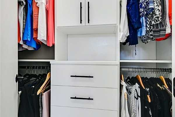 Photo #16 Custom built-ins and features in both closets for the owner