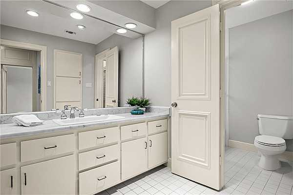 Photo #16 Primary bedroom closets and dressing area leads to ensuite bathroom
