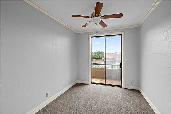 Photo #18 Built-in bookcase overlooks living room