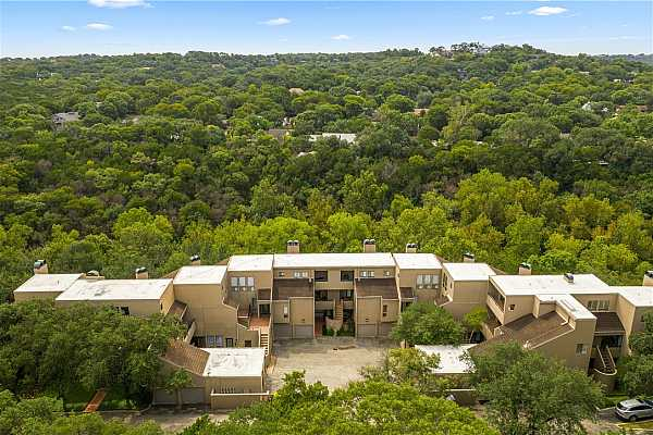 Photo #34 Unique property nestled in the wooded greenbelt