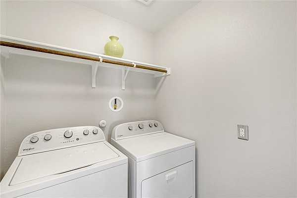Photo #18 The utility room has its own room and has enough room for extra storage above your washer and dryer. The laundry room is its own room on the second floor.
