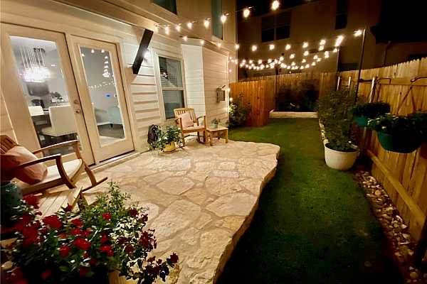Photo #28 The yard becomes even more enchanting at night with the string lights. It is a completely different feel and is the perfect place to entertain your guests.