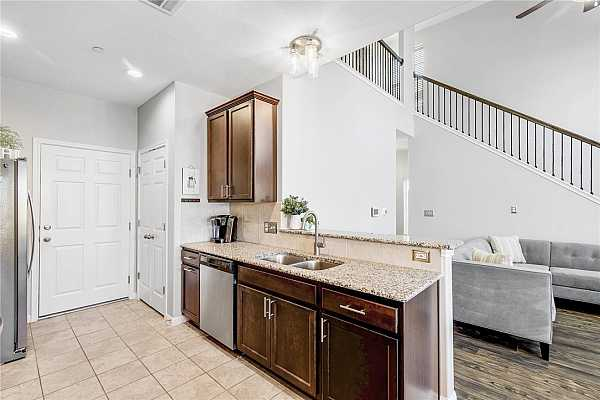 Photo #9 Beautiful, open floor plan with a lot of counter space and a large over-sized breakfast bar that extends into the living room.