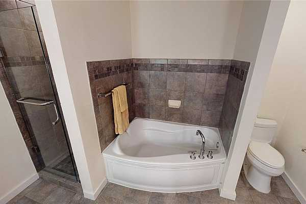 Photo #19 The primary bath has a separate shower and large soaking tub
