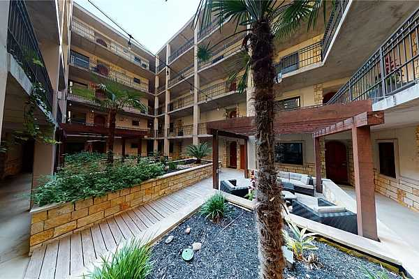 Photo #32 The building has a large courtyard and open spaces that give it a more homey feel than an anonymous tower