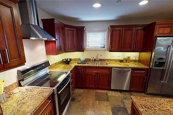 Photo #9 The kitchen offers ample storage, granite counters, and stainless steel appliances