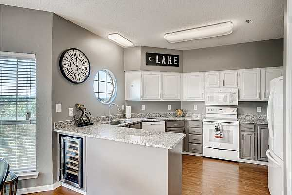 Photo #7 Open kitchen with plenty of counter space and built in wine-fridge.