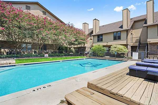 Photo #1 A desirable poolside unit with flowering tree views. Unit 219 is up the stairs to the left.