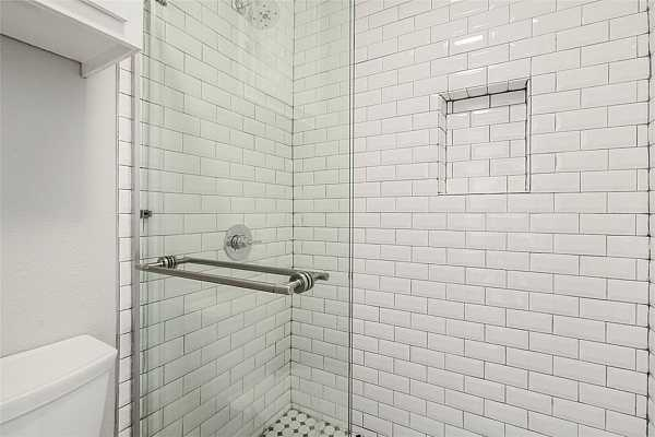 Photo #13 Walk-in Shower with new tile.