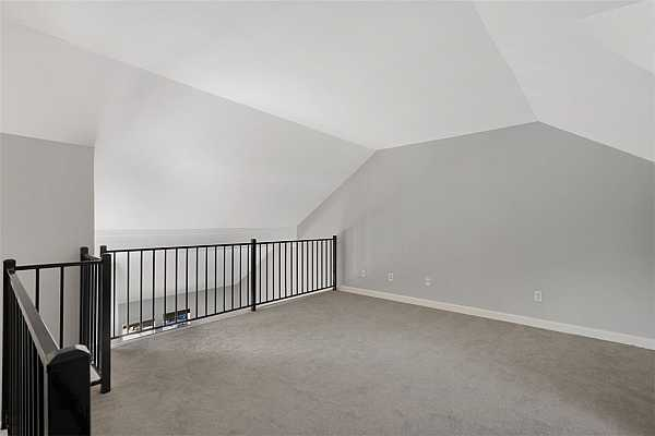 Photo #15 Newly carpeted loft has potential for an additional living area, work space or extra bedroom.