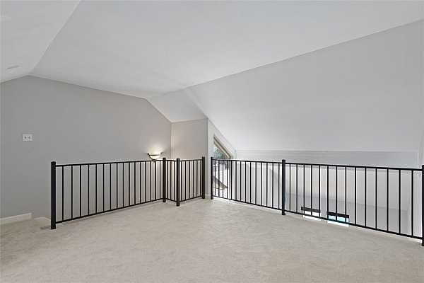 Photo #17 Plentiful natural light and appealing vaulted ceilings. Railings have been recently updated, too.