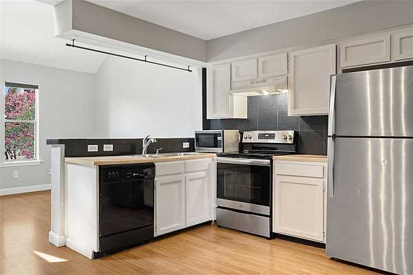 Photo #5 The eat-in kitchen opens to the living area. All appliances convey.