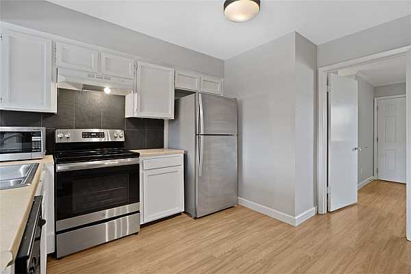 Photo #6 Recently updated stainless steel kitchen sink, range and refrigerator.