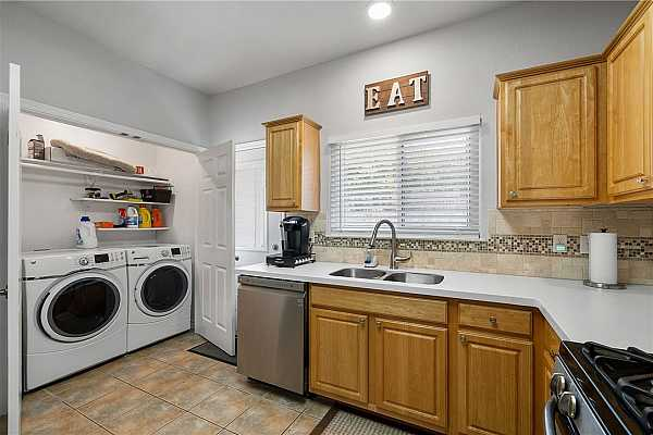 Photo #16 A laundry closet is located inside the home with plenty of shelving to store your household essentials. The washer and dryer are included in the sale!