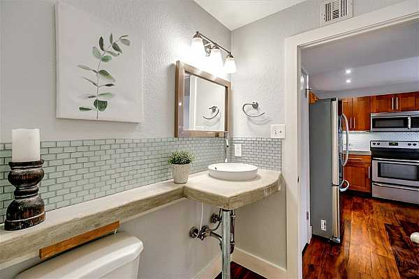 Photo #11 Guest bathroom is located on main level.
