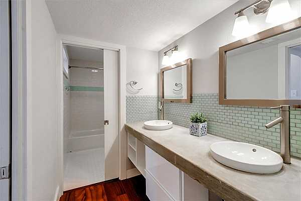 Photo #27 Upstairs bath has double sinks and mirrors.