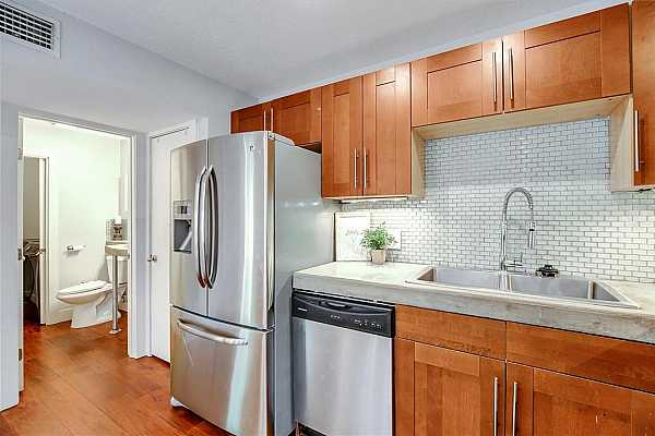 Photo #9 Glass backsplash and stainless appliances. The shaker style cabinets never go out of style!