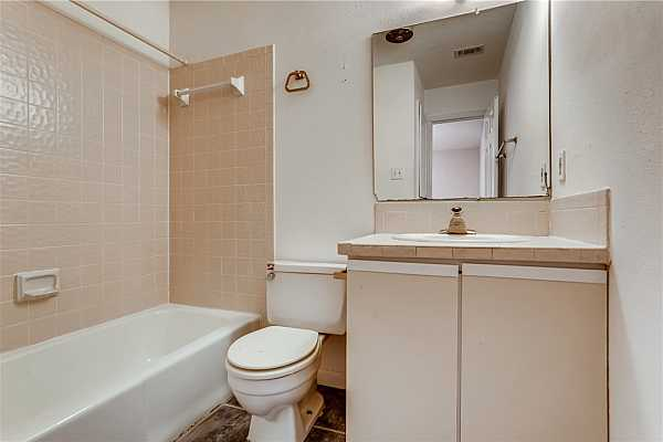 Photo #8 Full bathroom is attached to second bedroom.