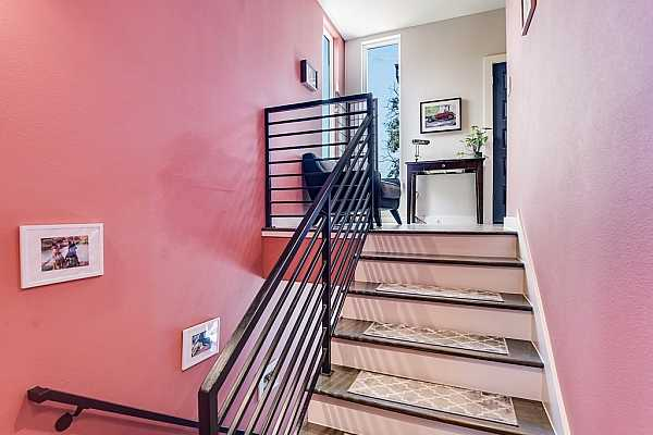 Photo #12 A beautiful split staircase with modern railing leads to the second floor.
