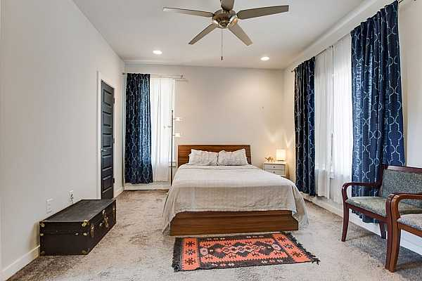 Photo #13 The primary suite offers plush carpet flooring, recessed lighting, a ceiling fan, and a generously sized walk-in closet!