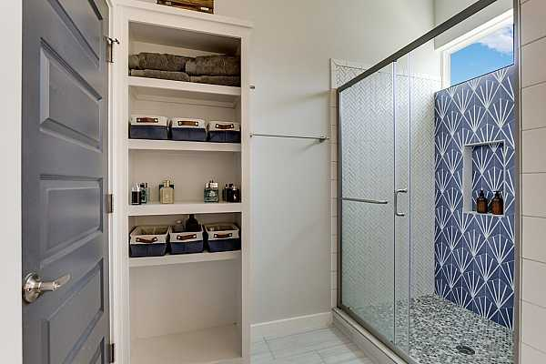 Photo #16 The primary bathroom also has built-in shelving for your storage needs.