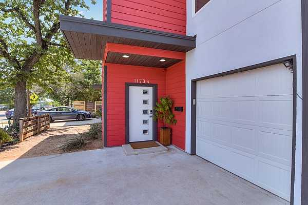 Photo #21 The home has great curb appeal and an attached 1-car garage with built-in overhead rack storage. The driveway can easily accommodate two vehicles.